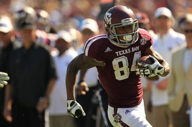 Oct 26, 2013; College Station, TX, USA; Texas A&M Aggies wide receiver Malcome Kennedy (84) runs after a catch against the Vanderbilt Commodores during the second half at Kyle Field. Texas A&M won 56-24. Mandatory Credit: Thomas Campbell-USA TODAY Sports