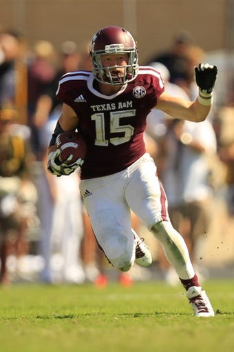 Oct 26, 2013; College Station, TX, USA; Texas A&M Aggies wide receiver Travis Labhart (15) returns a kick against the Vanderbilt Commodores during the second half at Kyle Field. Texas A&M won 56-24. Mandatory Credit: Thomas Campbell-USA TODAY Sports
