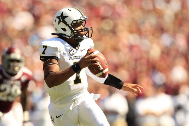 Oct 26, 2013; College Station, TX, USA; Vanderbilt Commodores quarterback Josh Grady (7) drops back to pass against the Texas A&M Aggies during the second half at Kyle Field. Texas A&M won 56-24. Mandatory Credit: Thomas Campbell-USA TODAY Sports