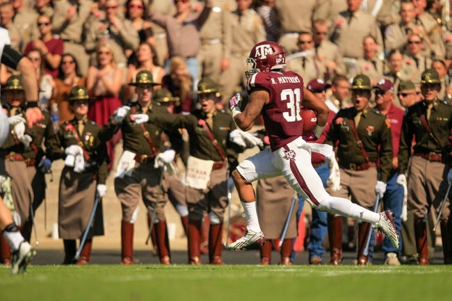 Oct 26, 2013; College Station, TX, USA; Texas A&M Aggies defensive back Howard Matthews (31) returns an interception for a touchdown against the Vanderbilt Commodores during the second half at Kyle Field. Texas A&M won 56-24. Mandatory Credit: Thomas Campbell-USA TODAY Sports