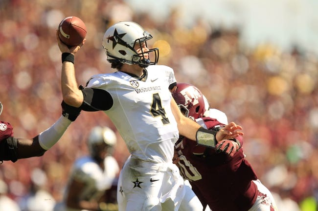 Oct 26, 2013; College Station, TX, USA; Texas A&M Aggies defensive lineman Daeshon Hall (10) hits Vanderbilt Commodores quarterback Patton Robinette (4) as he passes during the second half at Kyle Field. Texas A&M won 56-24. Mandatory Credit: Thomas Campbell-USA TODAY Sports