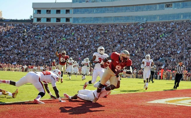 Oct 26, 2013; Tallahassee, FL, USA; Florida State Seminoles running back Karlos Williams (9) runs the ball for a touchdown during the first quarter against the North Carolina State Wolfpack at Doak Campbell Stadium. Mandatory Credit: Melina Vastola-USA TODAY Sports