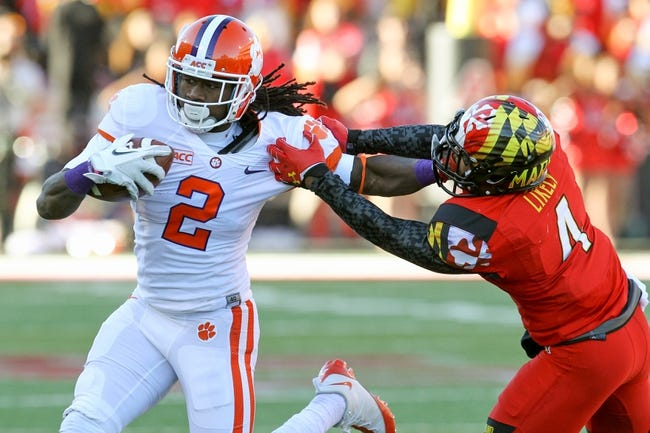 Oct 26, 2013; College Park, MD, USA; Clemson Tigers  wide receiver Sammy Watkins (2) tackled following his catch by Maryland Terrapins defensive back William Likely (4) at Byrd Stadium. Mandatory Credit: Mitch Stringer-USA TODAY Sports