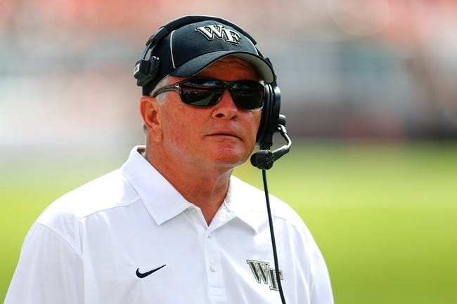 Oct 26, 2013; Miami Gardens, FL, USA; Wake Forest Demon Deacons head coach Jim Grobe in the second quarter of a game against the Miami Hurricanes at Sun Life Stadium. Mandatory Credit: Robert Mayer-USA TODAY Sports