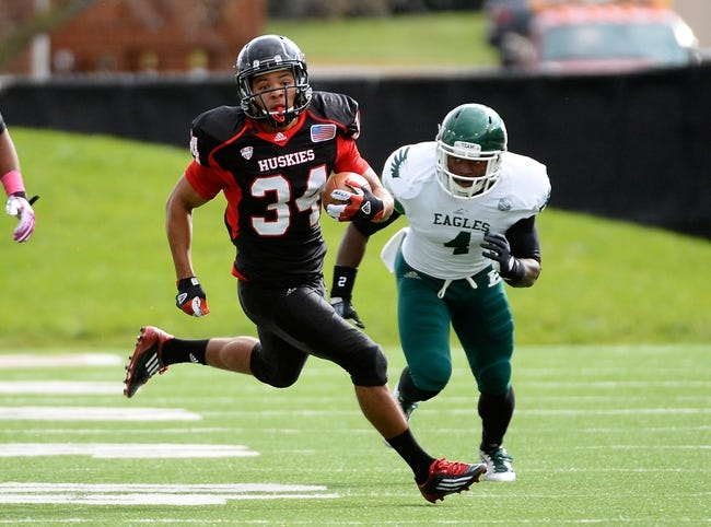 Oct 26, 2013; DeKalb, IL, USA; Northern Illinois Huskies running back James Spencer (34) rushes the ball past Eastern Michigan Eagles defensive back Willie Creear (4) during the first half at Huskie Stadium. Mandatory Credit: Mike DiNovo-USA TODAY Sports