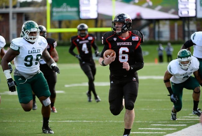 Oct 26, 2013; DeKalb, IL, USA; Northern Illinois Huskies quarterback Jordan Lynch (6) rushes for a touchdown against the Eastern Michigan Eagles during the first half at Huskie Stadium. Mandatory Credit: Mike DiNovo-USA TODAY Sports