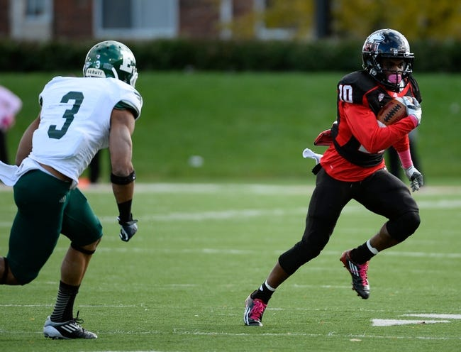 Oct 26, 2013; DeKalb, IL, USA; Northern Illinois Huskies wide receiver Tommylee Lewis (10) makes a catch against  Eastern Michigan Eagles defensive back Donald Coleman (3) during the first half at Huskie Stadium. Mandatory Credit: Mike DiNovo-USA TODAY Sports