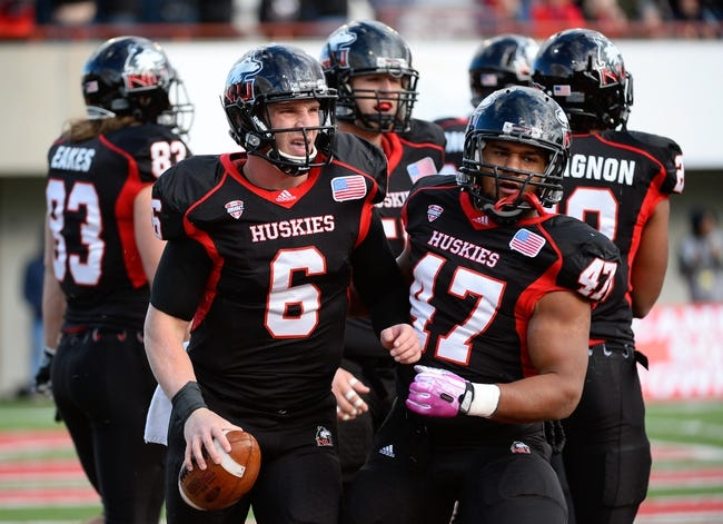 Oct 26, 2013; DeKalb, IL, USA; Northern Illinois Huskies quarterback Jordan Lynch (6) reacts after scoring a  touchdown against the Eastern Michigan Eagles during the first half at Huskie Stadium. Mandatory Credit: Mike DiNovo-USA TODAY Sports
