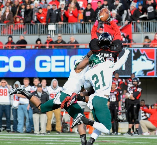 Oct 26, 2013; DeKalb, IL, USA; Northern Illinois Huskies wide receiver Tommylee Lewis (10) attempts to make a catch against Eastern Michigan Eagles defensive back Ja'Ron Gillespie (21) during the first half at Huskie Stadium. Mandatory Credit: Mike DiNovo-USA TODAY Sports