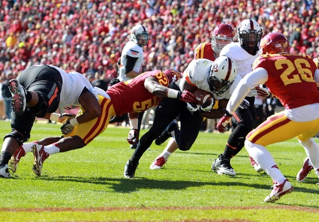 Oct 26, 2013; Ames, IA, USA; Iowa State Cyclones linebacker Jeremiah George (52) tackles Oklahoma State Cowboys running back Desmond Roland (26) in the end zone at Jack Trice Stadium.  The Cowboys beat the Cyclones 58-27.  Mandatory Credit: Reese Strickland-USA TODAY Sports