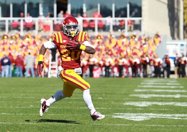Oct 26, 2013; Ames, IA, USA; Iowa State Cyclones DeVondrick Nealy (20) runs for a touchdown against the Oklahoma State Cowboys at Jack Trice Stadium.  The Cowboys beat the Cyclones 58-27.  Mandatory Credit: Reese Strickland-USA TODAY Sports