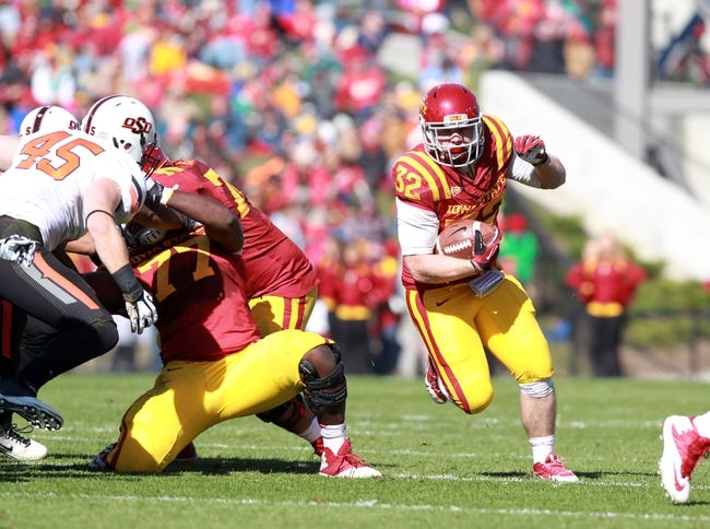 Oct 26, 2013; Ames, IA, USA; Iowa State Cyclones fullback Jeff Woody (32) runs for a first down against the Oklahoma State Cowboys at Jack Trice Stadium.  The Cowboys beat the Cyclones 58-27.  Mandatory Credit: Reese Strickland-USA TODAY Sports