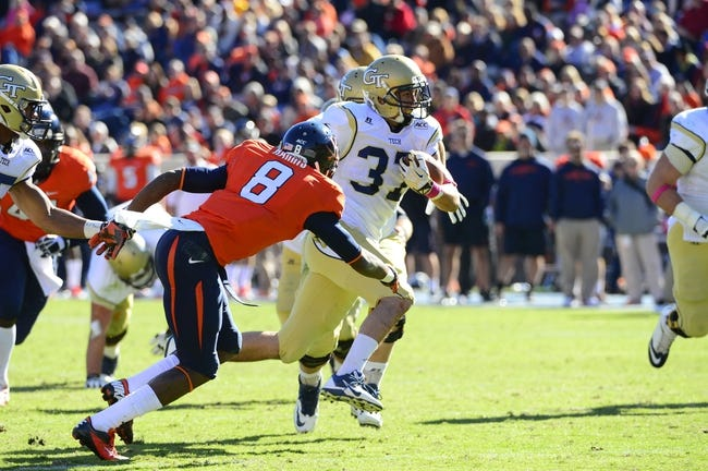 Oct 26, 2013; Charlottesville, VA, USA; Georgia Tech Yellow Jackets running back Zach Laskey (37) runs as Virginia Cavaliers safety Anthony Harris (8) defends in the third quarter. The Georgia Tech Yellow Jackets defeated the  Virginia Cavaliers 35-25 at Scott Stadium. Mandatory Credit: Bob Donnan-USA TODAY Sports