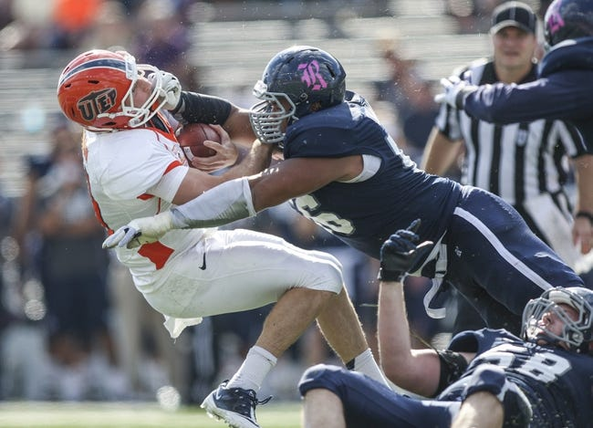 Oct 26, 2013; Houston, TX, USA; UTEP Miners quarterback Blaire Sullivan (10) is tackled by Rice Owls defensive tackle Christian Covington (56) during the second quarter at Rice Stadium. Mandatory Credit: Troy Taormina-USA TODAY Sports