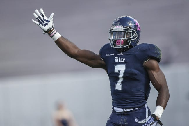 Oct 26, 2013; Houston, TX, USA; Rice Owls safety Julius White (7) signals after the Owls recover a fumble during the second quarter against the UTEP Miners at Rice Stadium. Mandatory Credit: Troy Taormina-USA TODAY Sports