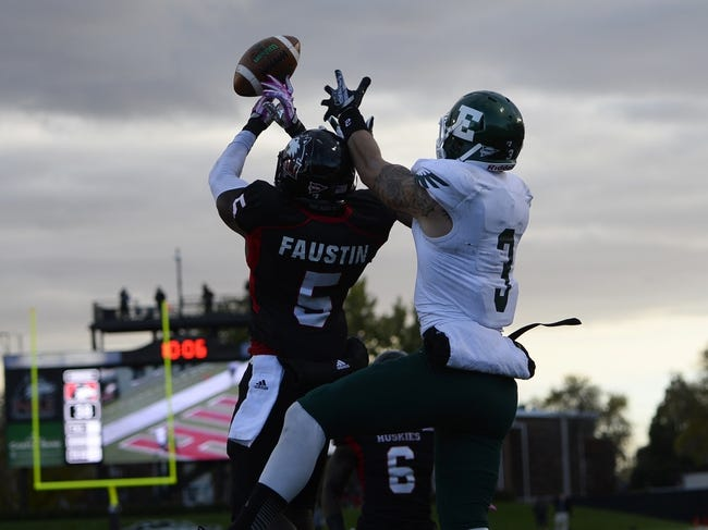 Oct 26, 2013; DeKalb, IL, USA; Northern Illinois Huskies cornerback Jhony Faustin (5) breaks up a pass against Eastern Michigan Eagles wide receiver Dustin Creel (3) during the second half at Huskie Stadium. Mandatory Credit: Mike DiNovo-USA TODAY Sports