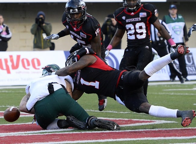 Oct 26, 2013; DeKalb, IL, USA; Northern Illinois Huskies safety Dechane Durante (1) breaks up a pass intended for Eastern Michigan Eagles wide receiver Dustin Creel (3) during the second half at Huskie Stadium. Mandatory Credit: Mike DiNovo-USA TODAY Sports