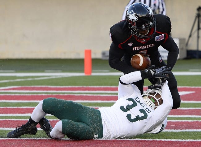 Oct 26, 2013; DeKalb, IL, USA; Northern Illinois Huskies wide receiver Da'Ron Brown (4) catches a touchdown against Eastern Michigan Eagles defensive back Quan Pace (33) during the second half at Huskie Stadium. Mandatory Credit: Mike DiNovo-USA TODAY Sports