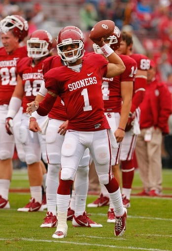 Oct 26, 2013; Norman, OK, USA; Oklahoma Sooners quarterback Kendal Thompson (1) warms up before a game against Texas Tech Red Raiders at Gaylord Family - Oklahoma Memorial Stadium. Mandatory Credit: Alonzo Adams-USA TODAY Sports