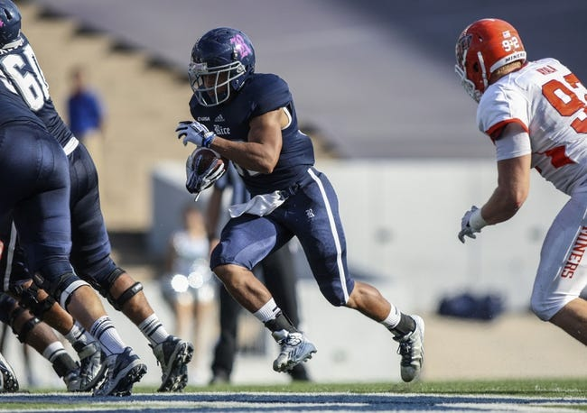 Oct 26, 2013; Houston, TX, USA; Rice Owls running back Darik Dillard (32) rushes during the third quarter against the UTEP Miners at Rice Stadium. Mandatory Credit: Troy Taormina-USA TODAY Sports