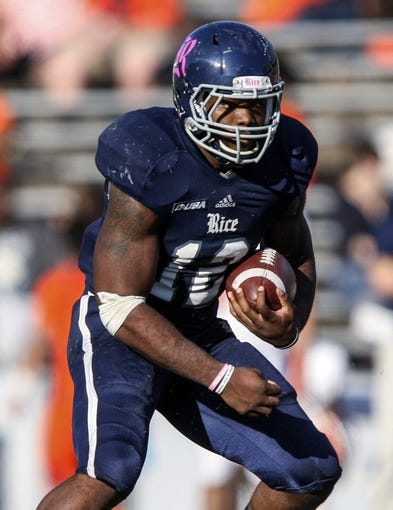 Oct 26, 2013; Houston, TX, USA; Rice Owls running back Charles Ross (12) runs with the ball during the fourth quarter against the UTEP Miners at Rice Stadium. Mandatory Credit: Troy Taormina-USA TODAY Sports