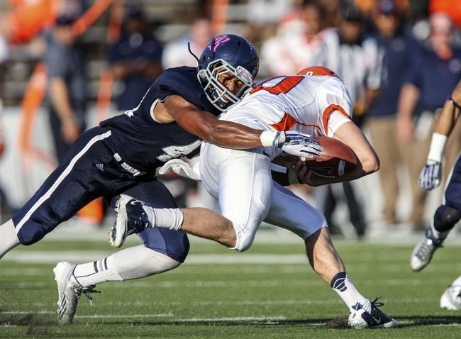 Oct 26, 2013; Houston, TX, USA; Rice Owls safety Gabe Baker (40) strips the ball from UTEP Miners quarterback Blaire Sullivan (10) during the fourth quarter at Rice Stadium. Mandatory Credit: Troy Taormina-USA TODAY Sports