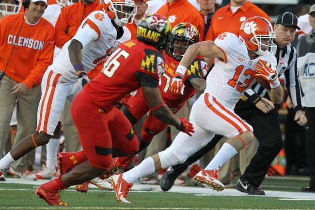Oct 26, 2013; College Park, MD, USA; Clemson Tigers wide receiver Adam Humphries (13) runs after his catch against the Maryland Terrapins at Byrd Stadium. Mandatory Credit: Mitch Stringer-USA TODAY Sports
