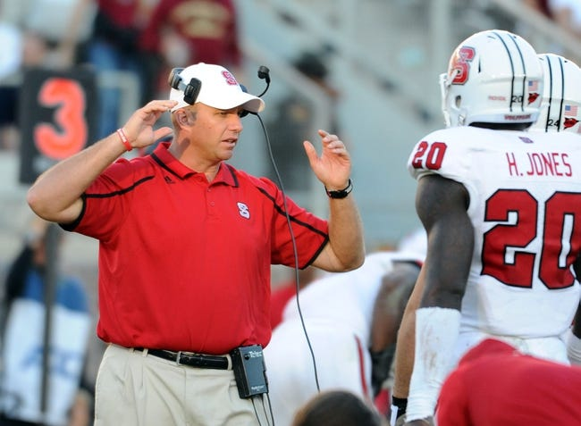 Oct 26, 2013; Tallahassee, FL, USA; North Carolina State Wolfpack head coach Dave Doeren speaks to players during the second half of the game against the Florida State Seminoles at Doak Campbell Stadium. Mandatory Credit: Melina Vastola-USA TODAY Sports