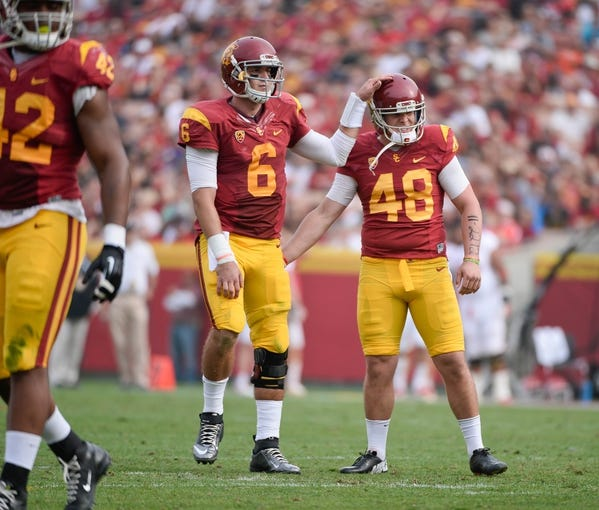 Oct 26, 2013; Los Angeles, CA, USA;  USC Trojans kicker Andre Heidari (48) is all smiles as he is congratulated by teammate Cody Kessler (6) after hitting a 40-yard field goal during the second half against the Utah Utes at Los Angeles Memorial Coliseum. The Trojans went on to a 19-0 win as Heidari hit four field goals in the game. Mandatory Credit: Robert Hanashiro-USA TODAY Sports