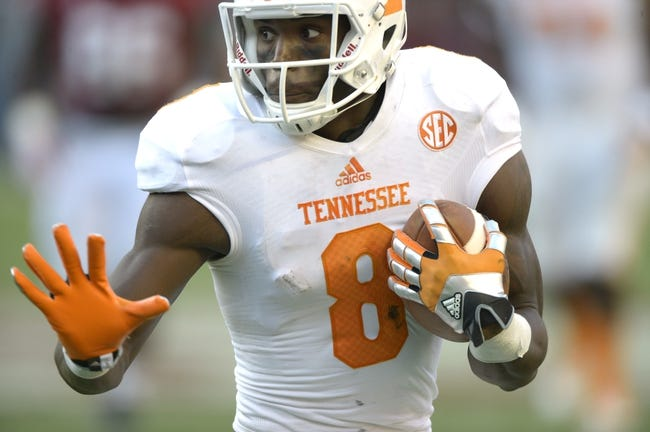 Oct 26, 2013; Tuscaloosa, AL, USA; Tennessee Volunteers wide receiver Marquez North (8) carries the ball up the field against the Alabama Crimson Tide during the first quarter at Bryant-Denny Stadium. Mandatory Credit: John David Mercer-USA TODAY Sports