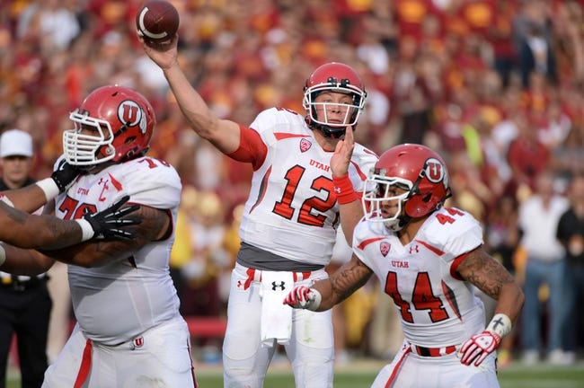 Oct 26, 2013; Los Angeles, CA, USA; Utah Utes quarterback Adam Schulz (12) throws a fourth quarter pass as offensive linesman Jeremiah Tofaeono (76) and Lucky Radley (44) provide protection against the USC Trojans at Los Angeles Memorial Coliseum. The Trojans won 19-3. Mandatory Credit: Robert Hanashiro-USA TODAY Sports