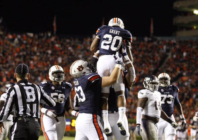Oct 26, 2013; Auburn, AL, USA; Auburn Tigers running back Anthony Grant (20) celebrates with linemen Chad Slade (62) and Alex Kozan (63) after scoring a touchdown against the Florida Atlantic Owls during the first half at Jordan Hare Stadium. Mandatory Credit: John Reed-USA TODAY Sports