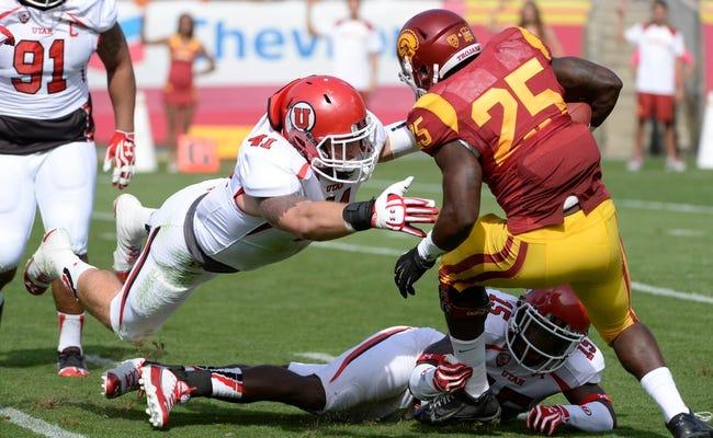 Oct 26, 2013; Los Angeles, CA, USA; Utah Utes linebacker Jared Norris (41) makes a diving tackle to stop USC Trojans running back Silas Redd (25) during first half at Los Angeles Memorial Coliseum. The Trojans won 19-3. Mandatory Credit: Robert Hanashiro-USA TODAY Sports