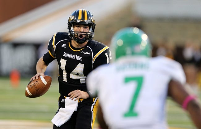 Oct 26, 2013; Hattiesburg, MS, USA; Southern Miss Golden Eagles quarterback Nick Mullens (14) looks to throw a pass against the North Texas Mean Green in the first quarter of their game at M.M. Roberts Stadium. Mandatory Credit: Chuck Cook-USA TODAY Sports