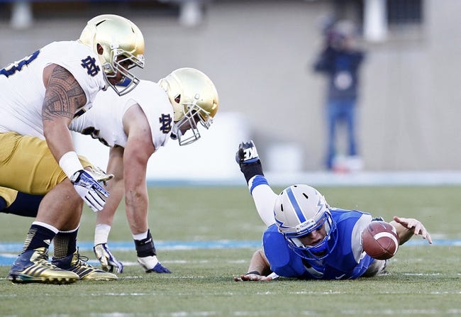 Oct 26, 2013; Colorado Springs, CO, USA; Air Force Falcons quarterback Nate Romine (6) fumbles the football in the third quarter against the Notre Dame Fighting Irish at Falcon Stadium. The Fighting Irish won 45-10. Mandatory Credit: Isaiah J. Downing-USA TODAY Sports