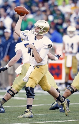 Oct 26, 2013; Colorado Springs, CO, USA; Notre Dame Fighting Irish quarterback Tommy Rees (11) throws the ball in the third quarter against the Air Force Falcons at Falcon Stadium. The Fighting Irish won 45-10. Mandatory Credit: Isaiah J. Downing-USA TODAY Sports