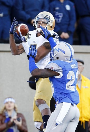 Oct 26, 2013; Colorado Springs, CO, USA; Air Force Falcons defensive back Steffon Batts (23) guards Notre Dame Fighting Irish wide receiver TJ Jones (7) as he makes a catch for a touchdown in the third quarter at Falcon Stadium. The Fighting Irish won 45-10. Mandatory Credit: Isaiah J. Downing-USA TODAY Sports