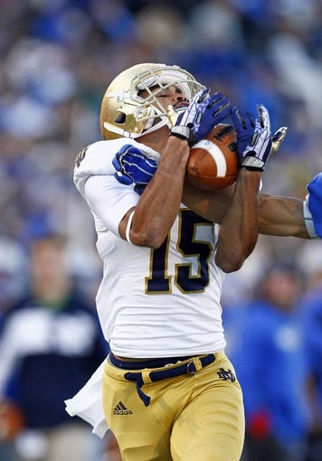 Oct 26, 2013; Colorado Springs, CO, USA; Notre Dame Fighting Irish wide receiver William Fuller (15) makes a catch in the fourth quarter against the Air Force Falcons at Falcon Stadium. The Fighting Irish won 45-10. Mandatory Credit: Isaiah J. Downing-USA TODAY Sports