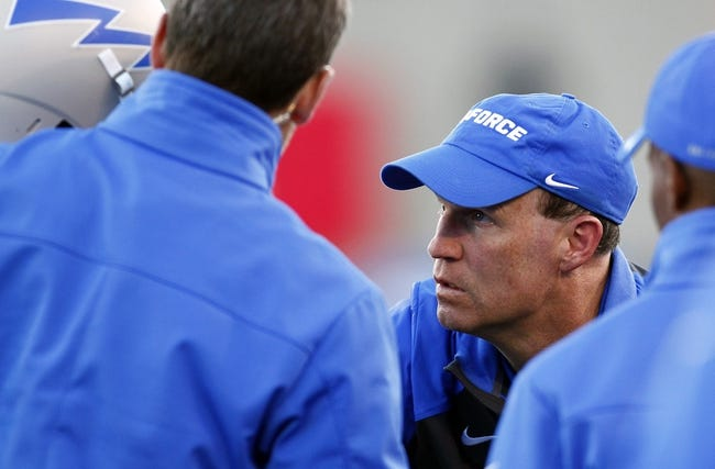 Oct 26, 2013; Colorado Springs, CO, USA; Air Force Falcons head coach Troy Calhoun talks with a player in the third quarter against the Notre Dame Fighting Irish at Falcon Stadium. The Fighting Irish won 45-10. Mandatory Credit: Isaiah J. Downing-USA TODAY Sports