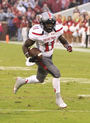 Oct 26, 2013; Norman, OK, USA; Texas Tech Red Raiders wide receiver Jakeem Grant (11) runs for the end zone against the Oklahoma Sooners during the third quarter at Gaylord Family - Oklahoma Memorial Stadium. Oklahoma won 38-30.  Mandatory Credit: Alonzo Adams-USA TODAY Sports