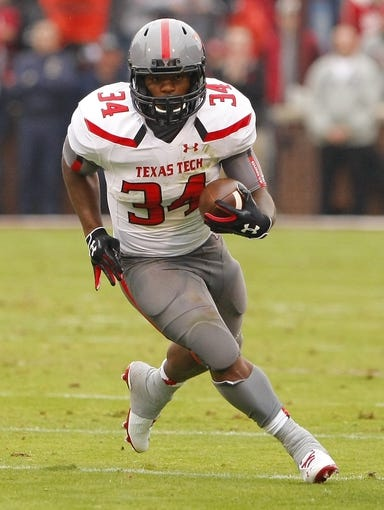 Oct 26, 2013; Norman, OK, USA; Texas Tech Red Raiders running back Kenny Williams (34) runs with the ball against Oklahoma during the second quarter at Gaylord Family - Oklahoma Memorial Stadium. Oklahoma won 38-30. Mandatory Credit: Alonzo Adams-USA TODAY Sports