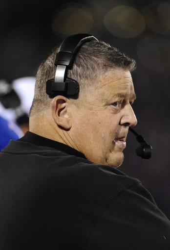 Oct 26, 2013; Lawrence, KS, USA; Kansas Jayhawks head coach Charlie Weis stands on the sidelines against the Baylor Bears in the first half at Memorial Stadium. Mandatory Credit: John Rieger-USA TODAY Sports