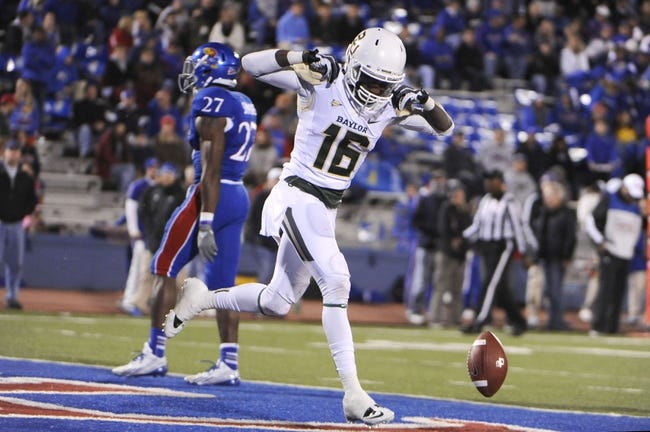 Oct 26, 2013; Lawrence, KS, USA; Baylor Bears wide receiver Tevin Reese (16) celebrates after scoring a touchdown against the Kansas Jayhawks in the first half at Memorial Stadium. Mandatory Credit: John Rieger-USA TODAY Sports