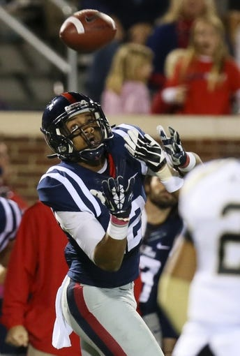 Oct 26, 2013; Oxford, MS, USA; Mississippi Rebels wide receiver Donte Moncrief (12) looks up for a pass against the Idaho Vandals at Vaught-Hemingway Stadium. Mandatory Credit: Spruce Derden-USA TODAY Sports