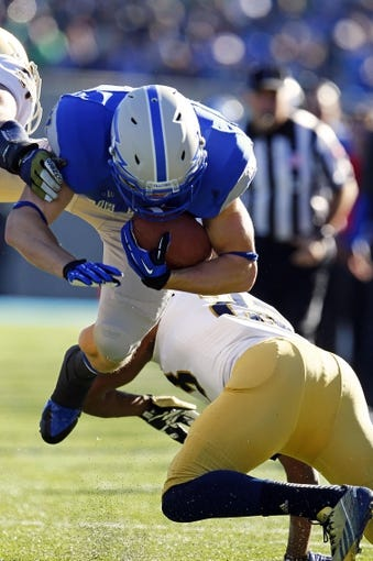 Oct 26, 2013; Colorado Springs, CO, USA; Air Force Falcons running back Anthony LaCoste (37) dives with the ball in the first quarter against the Notre Dame Fighting Irish at Falcon Stadium. Mandatory Credit: Isaiah J. Downing-USA TODAY Sports