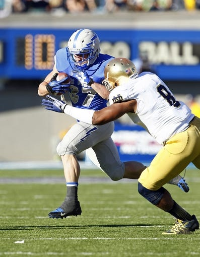 Oct 26, 2013; Colorado Springs, CO, USA; Notre Dame Fighting Irish inside linebacker Kendall Moore (8) tackles Air Force Falcons running back Anthony LaCoste (37) in the second quarter at Falcon Stadium. Mandatory Credit: Isaiah J. Downing-USA TODAY Sports