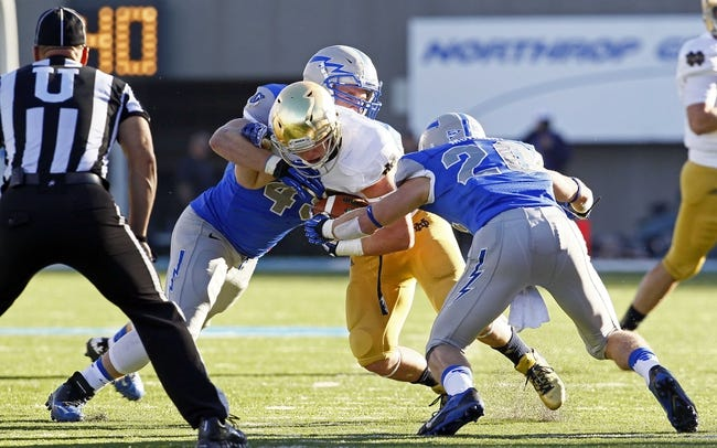 Oct 26, 2013; Colorado Springs, CO, USA; Air Force Falcons linebacker Joey Nichol (49) and defensive back Gavin McHenry (20) tackle Notre Dame Fighting Irish running back Cam McDaniel (33) in the second quarter at Falcon Stadium. Mandatory Credit: Isaiah J. Downing-USA TODAY Sports