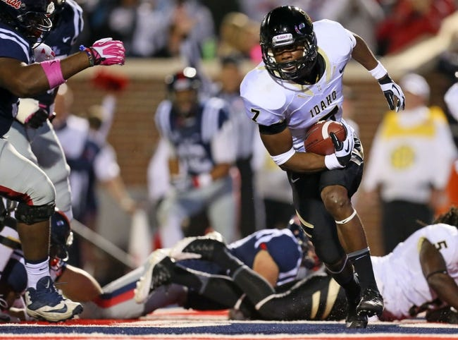 Oct 26, 2013; Oxford, MS, USA; Idaho Vandals safety Trey Williams (7) runs with the ball against the Mississippi Rebels at Vaught-Hemingway Stadium. Mandatory Credit: Spruce Derden-USA TODAY Sports