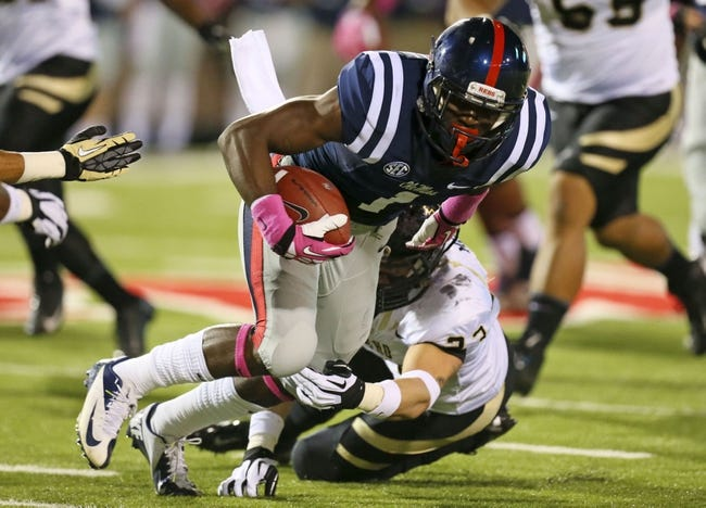Oct 26, 2013; Oxford, MS, USA; Mississippi Rebels wide receiver Laquon Treadwell (1) advances the ball during the game against the Idaho Vandals at Vaught-Hemingway Stadium. Mandatory Credit: Spruce Derden-USA TODAY Sports