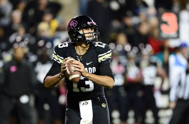 Oct 26, 2013; Boulder, CO, USA; Colorado Buffaloes quarterback Sefo Liufau (13) prepares to pass in the second quarter against the Arizona Wildcats at Folsom Field. Mandatory Credit: Ron Chenoy-USA TODAY Sports
